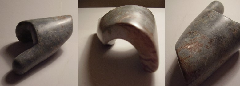 An exercise to find a shape that can be playfully grasped with two hands. Final model in soap stone.